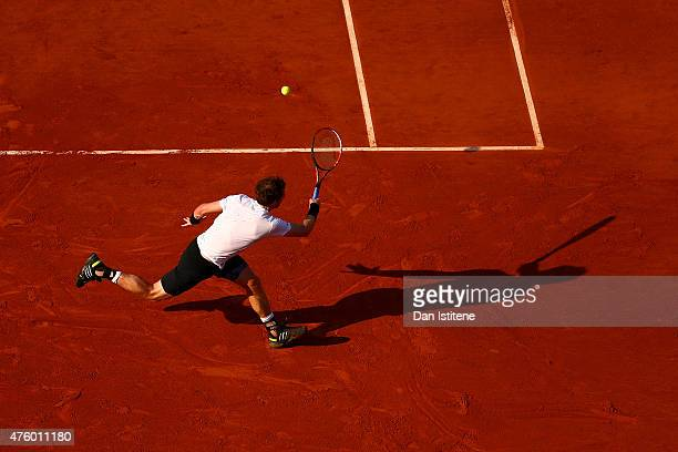 Andy Murray of Great Britain returns a shot in his Men's Semi Final match against Novak Djokovic of Serbia on day thirteen of the 2015 French Open at...