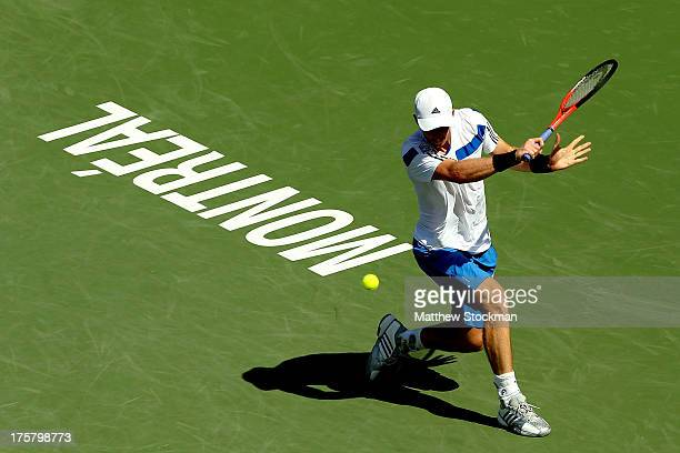 Andy Murray of Great Britain returns a shot to Ernests Gulbis of Latvia during the Rogers Cup at Uniprix Stadium on August 8, 2013 in Montreal,...
