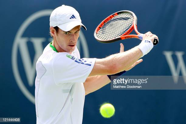 Andy Murray of Great Britain returns a shot to Gilles Simon of France during the Western Southern Open at the Lindner Family Tennis Center on August...