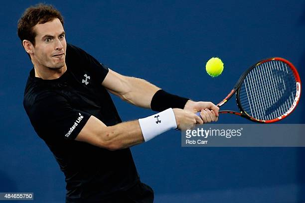 Andy Murray of Great Britain returns a shot to Grigor Dimitrov of Bulgaria during the Western Southern Open at the Linder Family Tennis Center on...