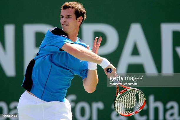Andy Murray of Great Britain returns a shot to Ivan Ljubicic of Croatia during the BNP Paribas Open at the Indian Wells Tennis Garden March 19 2009...