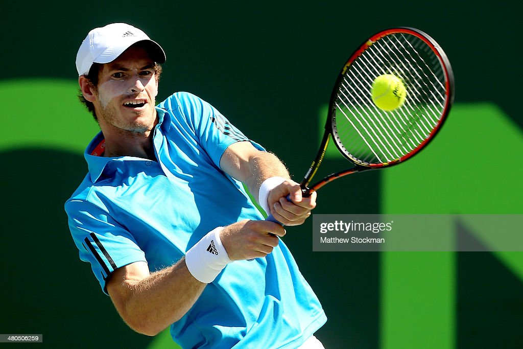 Andy Murray of Great Britain returns a shot to Jo-Wilfired Tsonga of France during the Sony Open at the Crandon Park Tennis Center on March 25, 2014 in Key Biscayne, Florida.