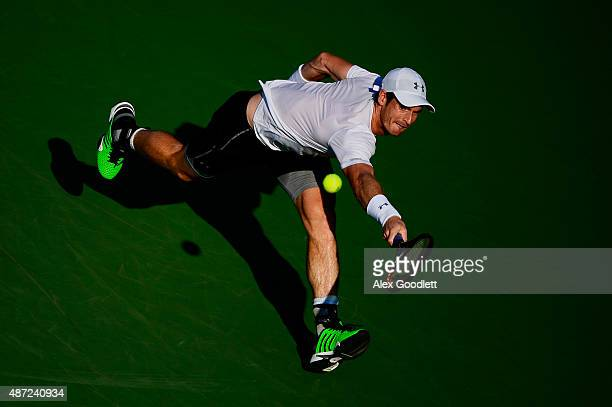 Andy Murray of Great Britain returns a shot to Kevin Anderson of South Africa during their Men's Singles Fourth Round match on Day Eight of the 2015...