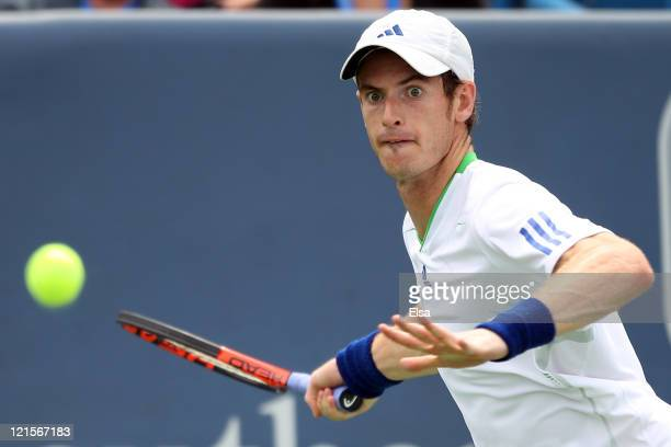 Andy Murray of Great Britain returns a shot to Mardy Fish during the Western & Southern Open at the Lindner Family Tennis Center on August 20, 2011...