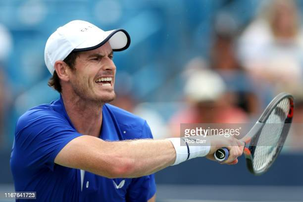 Andy Murray of Great Britain returns a shot to Richard Gasquet of France during Day 3 of the Western and Southern Open at Lindner Family Tennis...