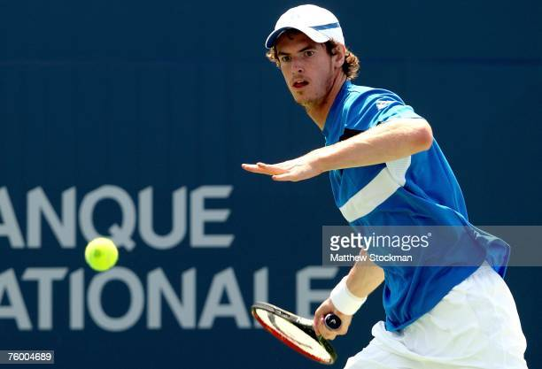 Andy Murray of Great Britain returns a shot to Robby Ginepri of the United States during the Coupe Rogers August 7, 2007 at Stade Uniprix in...
