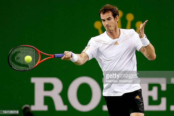 Andy Murray of Great Britain returns a shot to0 Novak Djokovic of Serbia during the final of the Shanghai Rolex Masters at the Qi Zhong Tennis Center...