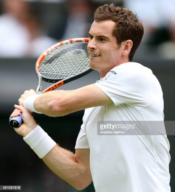 Andy Murray of Great Britain returns the ball during his Gentlemen's Singles first round match against David Goffin of Belgium during the Wimbledon...