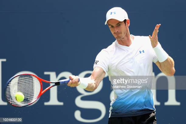 Andy Murray of Great Britain returns the ball in his mens singles first round match against James Duckworth of Australia on Day One of the 2018 US...