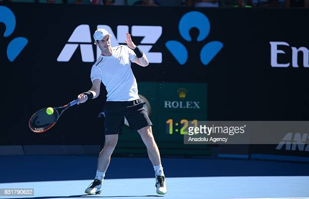 Andy Murray of Great Britain returns the ball to Illya Marchenko of Ukraine during their men's singles first round match on day one of the Australian...