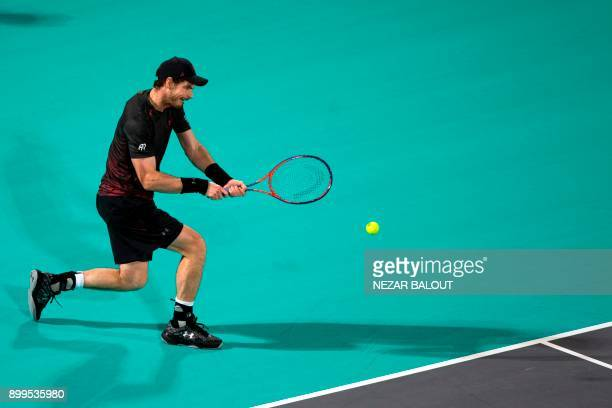 Andy Murray of Great Britain returns the ball to Roberto Bautista Agut of Spain during the Mubadala World Tennis Championship 2017 match in Abu Dhabi...