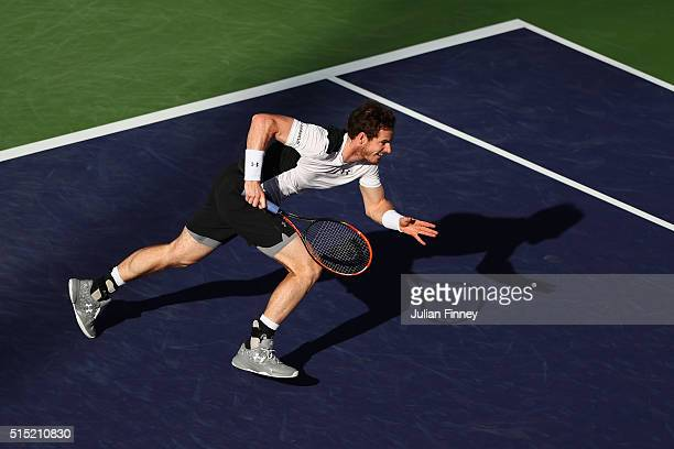 Andy Murray of Great Britain runs for a shot against Marcel Granollers of Spain during day six of the BNP Paribas Open at Indian Wells Tennis Garden...