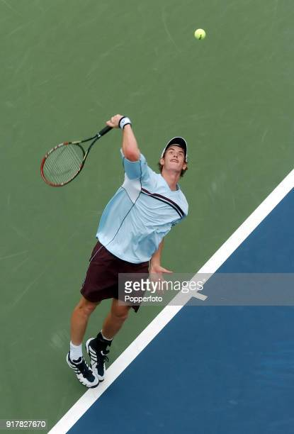 Andy Murray of Great Britain serves against Andrei Pavel during their first round match at the US Open at the USTA National Tennis Center in Flushing...