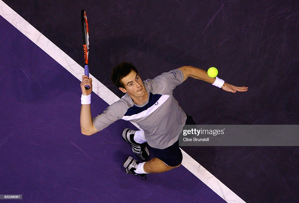 Andy Murray of Great Britain serves against Roger Federer of Switzerland during their semi final match at the Madrid Masters tennis tournament at the Madrid Arena on October 18, 2008 in Madrid, Spain.