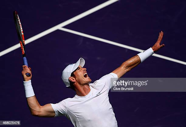 Andy Murray of Great Britain serves against Santiago Giraldo of Columbia in their third round match during the Miami Open Presented by Itau at...