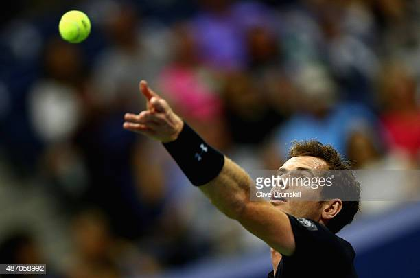 Andy Murray of Great Britain serves against Thomaz Bellucci of Brazil during their mens singles third round match on Day Six of the 2015 US Open at...