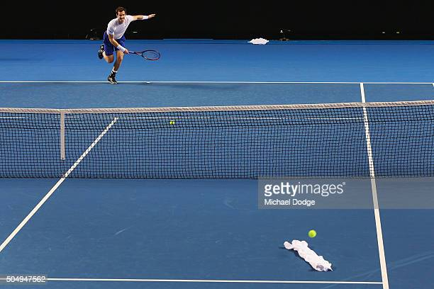Andy Murray of Great Britain serves at a white towell during a practice session ahead of the 2016 Australian Open at Melbourne Park on January 14...