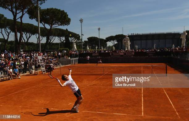 Andy Murray of Great Britain serves during a practice session prior to the start of the Internazoinali BNL D'Italia at the Foro Italico Tennis Centre...