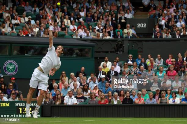 Andy Murray of Great Britain serves during his Gentlemen's Singles first round match against Nikolay Davydenko of Russia on day two of the Wimbledon...