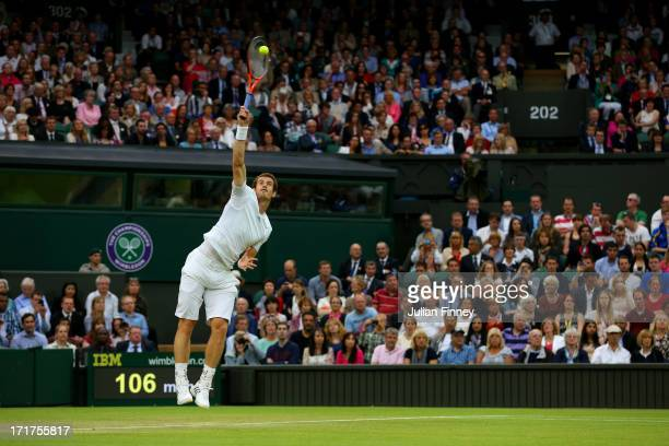 Andy Murray of Great Britain serves during his Gentlemen's Singles third round match against Tommy Robredo of Spain on day five of the Wimbledon Lawn...