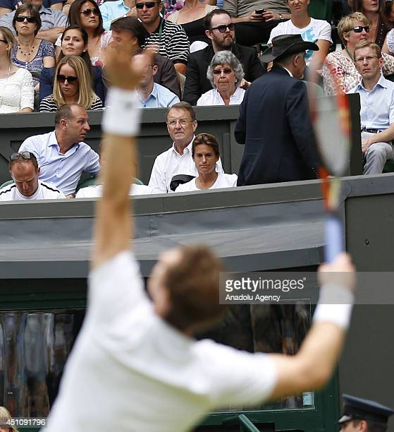 Andy Murray of Great Britain serves during his Gentlemen's Singles first round match against David Goffin of Belgium on day one of the Wimbledon Lawn...