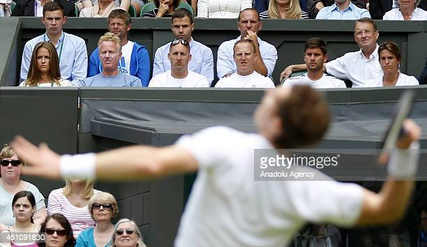 Andy Murray of Great Britain serves during his Gentlemen's Singles first round match against David Goffin of Belgium during the Wimbledon Lawn Tennis...
