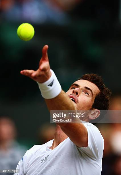 Andy Murray of Great Britain serves during his Gentlemen's Singles fourth round match against Kevin Anderson of South Africa on day seven of the...