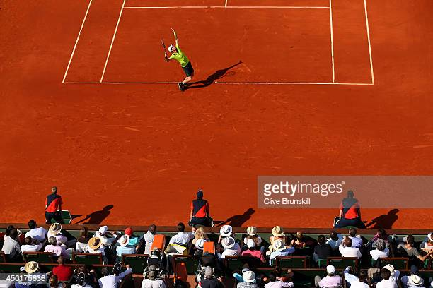 Andy Murray of Great Britain serves during his men's singles match against Rafael Nadal of Spain on day thirteen of the French Open at Roland Garros...