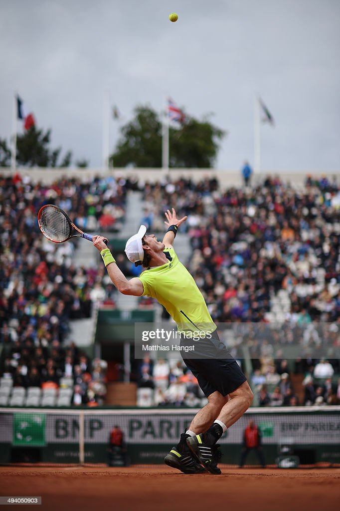 Andy Murray of Great Britain serves during his men's singles match against Andrey Golubev of Kazakhstan on day three of the French Open at Roland Garros on May 27, 2014 in Paris, France.