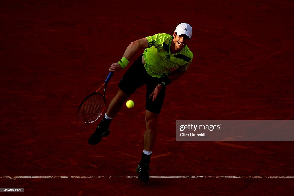 Andy Murray of Great Britain serves during his men's singles match against Philipp Kohlschreiber of Germany on day seven of the French Open at Roland Garros on May 31, 2014 in Paris, France.