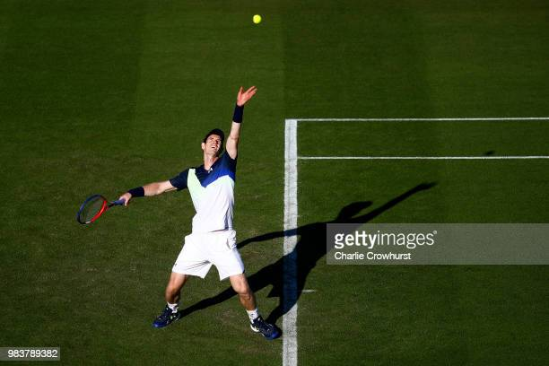 Andy Murray of Great Britain serves during his mens singles match against Stan Wawrinka of Switzerland during Day Four of the Nature Valley...