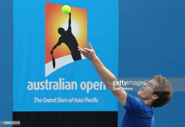 Andy Murray of Great Britain serves during practice ahead of the 2012 Australian Open at Rod Laver Arena on January 12 2012 in Melbourne Australia