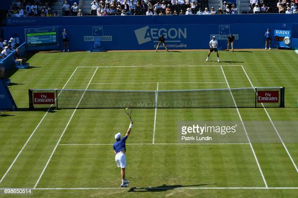 Andy Murray of Great Britain serves during the 1st round match against Jordan Thompson of Australia at Queens Club on June 20 2017 in London England