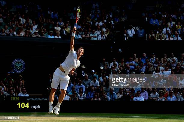 Andy Murray of Great Britain serves during the Gentlemen's Singles semi-final match against Jerzy Janowicz of Poland on day eleven of the Wimbledon...
