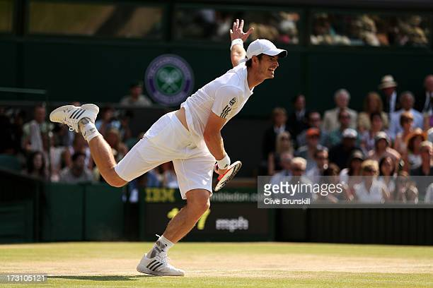 Andy Murray of Great Britain serves during the Gentlemen's Singles Final match against Novak Djokovic of Serbia on day thirteen of the Wimbledon Lawn...