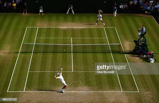 Andy Murray of Great Britain serves during the Gentlemens Singles Semi Final match against Roger Federer of Switzerland during day eleven of the...