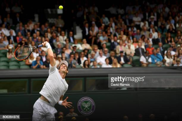 Andy Murray of Great Britain serves during the Gentlemen's Singles first round match on day one of the Wimbledon Lawn Tennis Championships at the All...