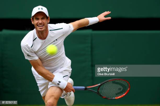 Andy Murray of Great Britain serves during the Gentlemen's Singles quarter final match against Sam Querrey of The United States on day nine of the...