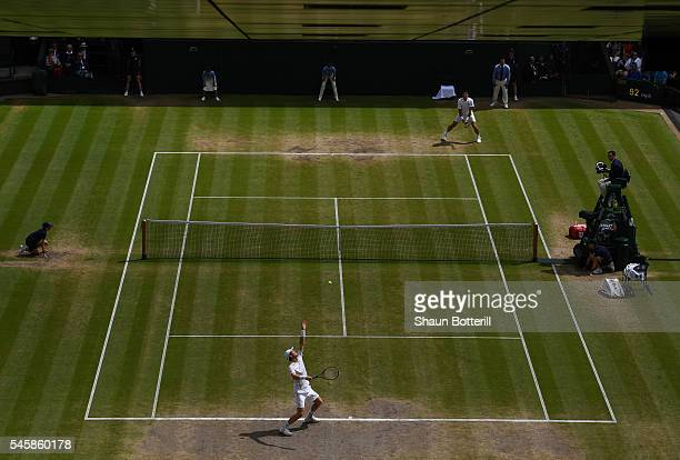 Andy Murray of Great Britain serves during the Men's Singles Final against Milos Raonic of Canada on day thirteen of the Wimbledon Lawn Tennis...