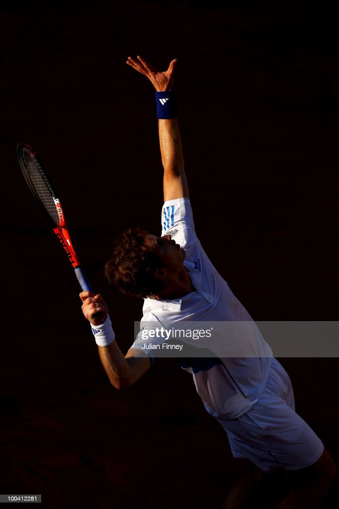 Andy Murray of Great Britain serves during the men's singles first round match between Andy Murray of Great Britain and Richard Gasquet of France on day two of the French Open at Roland Garros on May 24, 2010 in Paris, France.