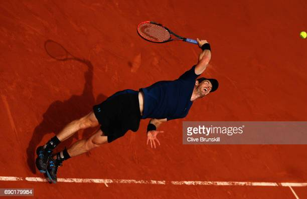 Andy Murray of Great Britain serves during the mens singles first round match Andrey Kuznetsov of Russia on day three of the 2017 French Open at...