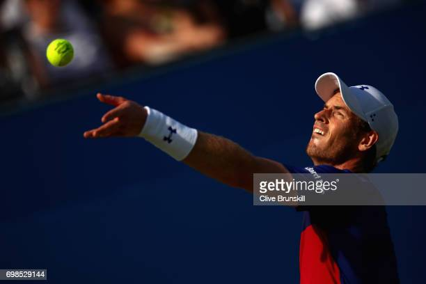 Andy Murray of Great Britain serves during the mens singles first round match against Jordan Thompson of Australia on day two of the 2017 Aegon...