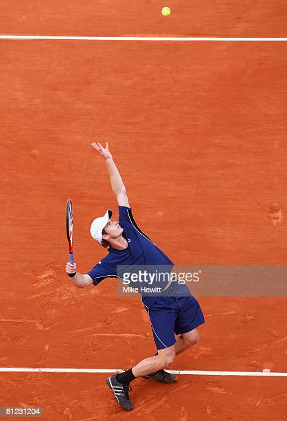 Andy Murray of Great Britain serves during the Men's Singles first round match against Jonathan Eysseric of France on day one of the French Open at...