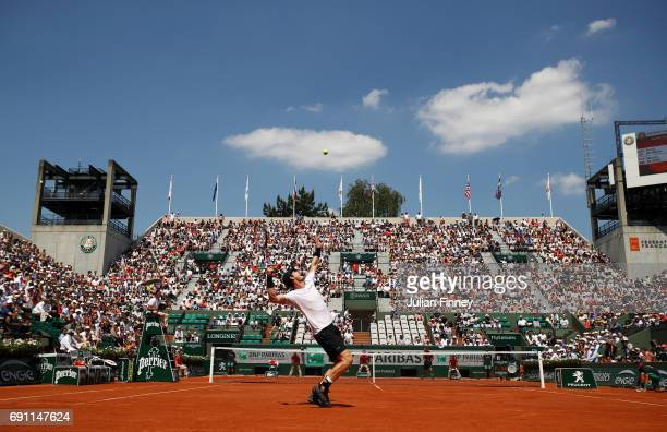 Andy Murray of Great Britain serves during the men's singles second round match against Martin Klizan of Slovakia on day five of the 2017 French Open...