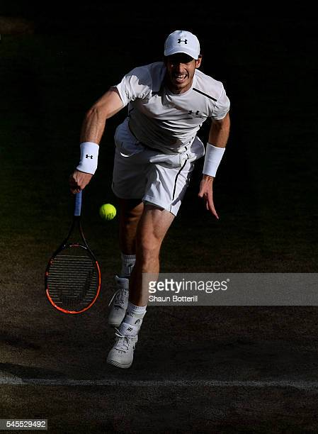 Andy Murray of Great Britain serves during the Men's Singles Semi Final match against Tomas Berdych of The Czech Republic on day eleven of the...