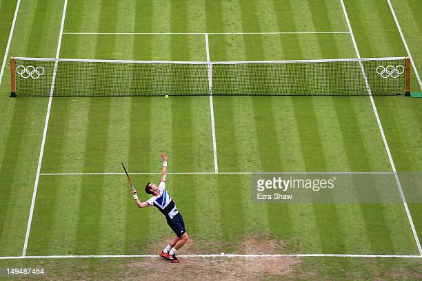 Andy Murray of Great Britain serves during the Men's Singles Tennis match against Stanislas Wawrinka of Switzerland on Day 2 of the London 2012...