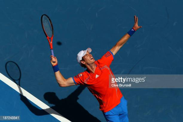 Andy Murray of Great Britain serves in his first round match against Ryan Harrison of the USA during day two of the 2012 Australian Open at Melbourne...