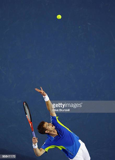 Andy Murray of Great Britain serves in his first round match against Kevin Anderson of South Africa during day one of the 2010 Australian Open at...