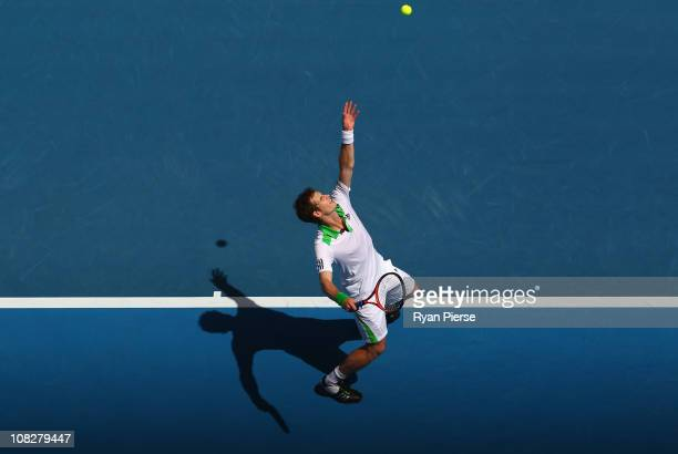 Andy Murray of Great Britain serves in his fourth round match against Jurgen Melzer of Austria during day eight of the 2011 Australian Open at...
