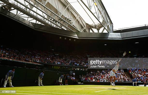 Andy Murray of Great Britain serves in his Gentlemen's Singles Fourth Round match against Ivo Karlovic of Croatia during day seven of the Wimbledon...